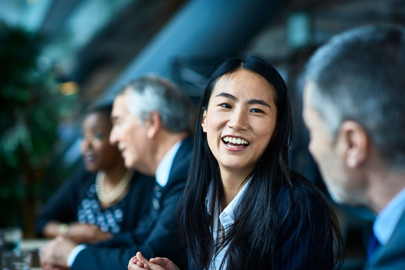 smiling woman looking at colleague