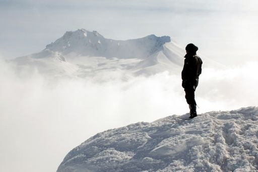 Climber on top of a mountain