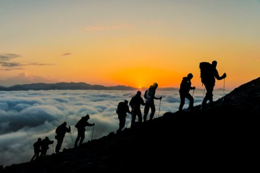 Climbers group on mountain during sunset