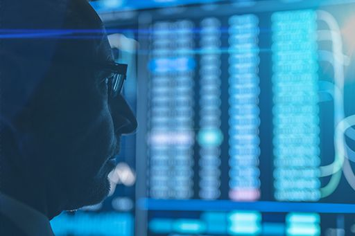 Close-up face of man in blue server room