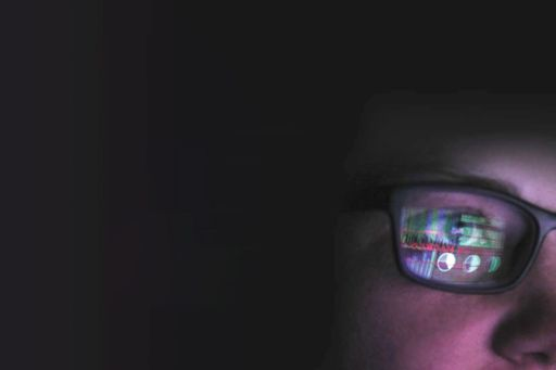 Close-up of face looking at a computer screen