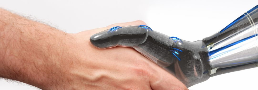 closeup of human shaking hands with robot