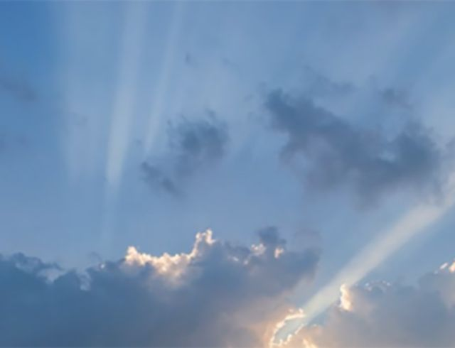 Video time lapse of clouds and sun flares
