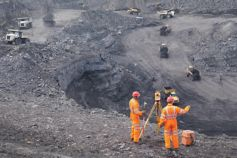 Coal miners surveying from above