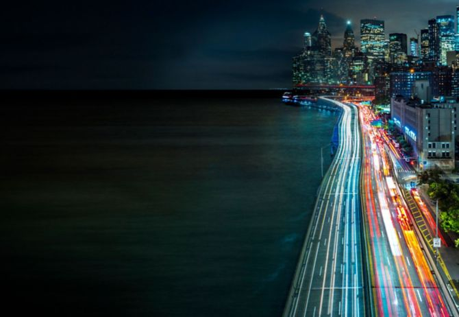 Cityscape with illuminated highway