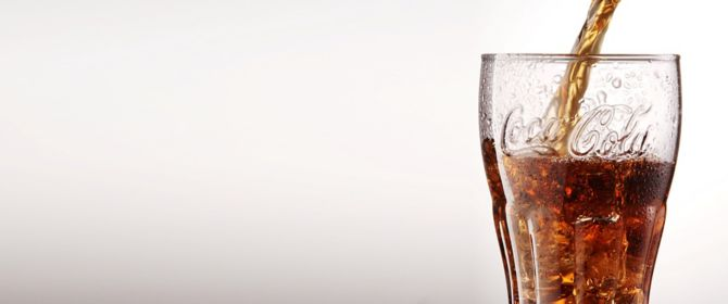 Coca-cola being poured in glass