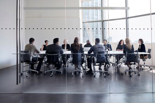 Colleagues sitting at a boardroom table