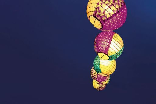 Colorful lighted lamps in air