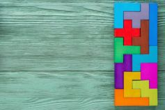 Reinventing work - colorful-tetris-blocks-joint-wooden-background