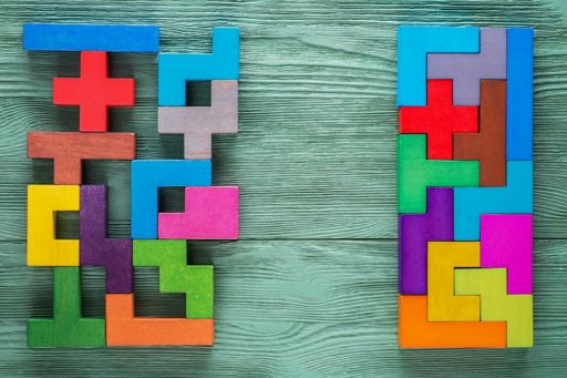 Colourful tetris blocks placed on wooden table
