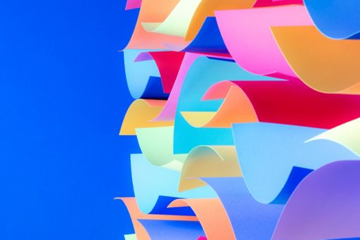 Coloured sheets of paper on a blue background