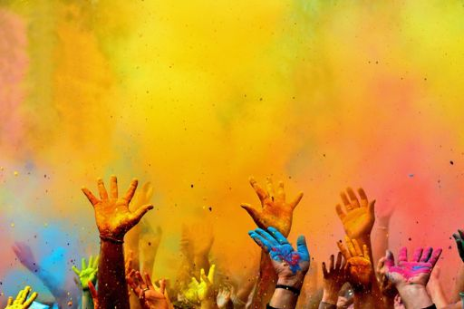 colourful hands up in the air