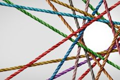 Colourful threads crossing each other to make a circle