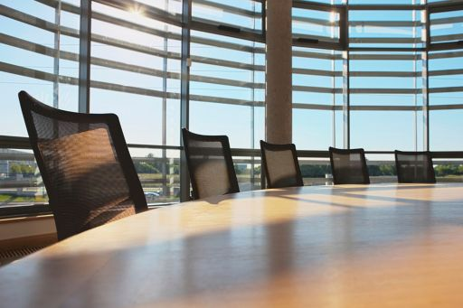 comfortable office chairs around a circular conference