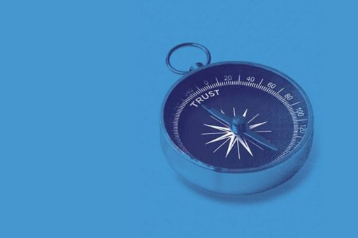 A compass pointing to the word trust