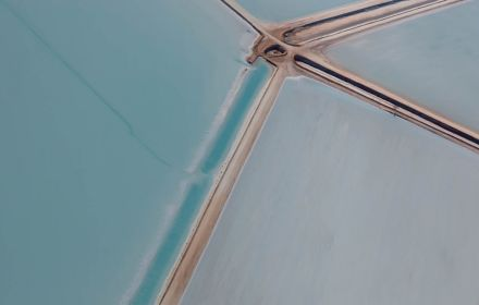 Converging roads between water