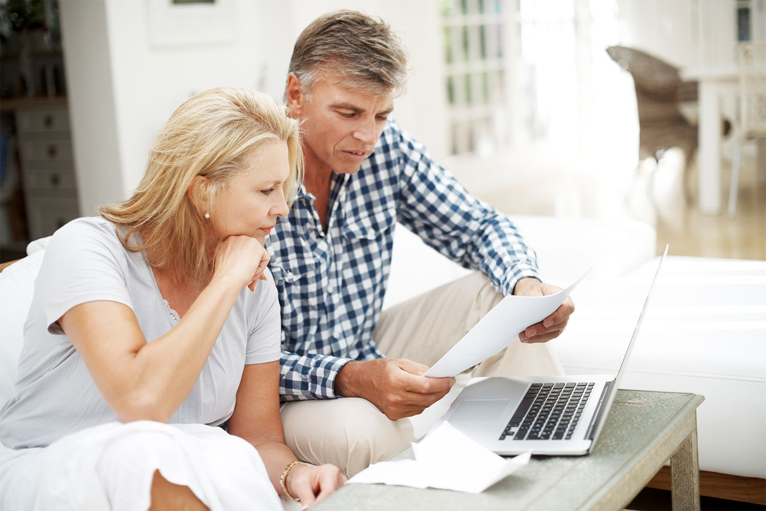 couple looking at the laptop