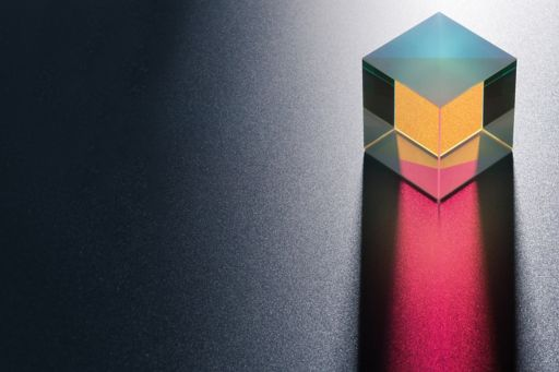 Crystal cube containing yellow and pink colours