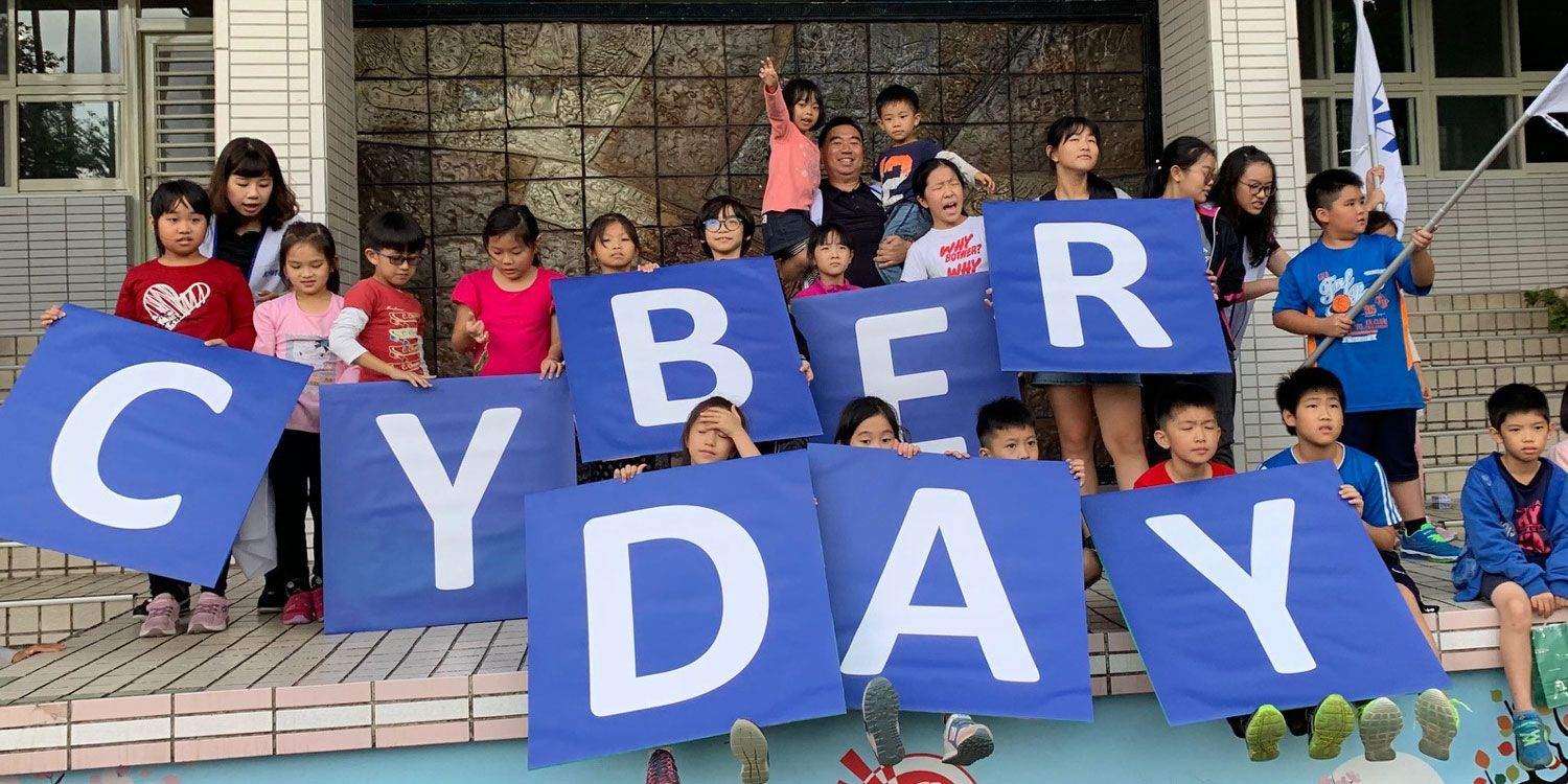 Kids with letters spelling Cyber Day