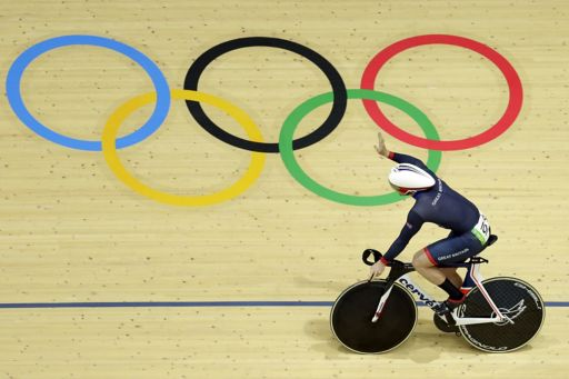 Cyclist over olympic rings
