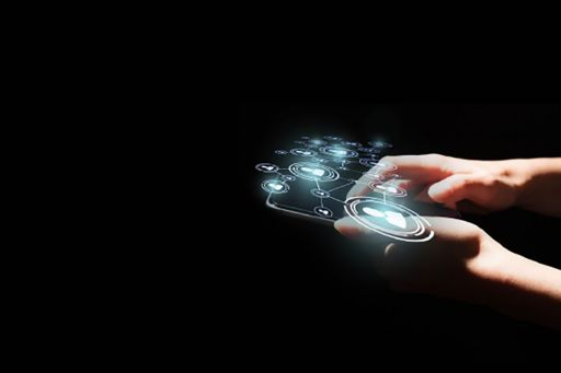 Digital mobile device in hand on black background