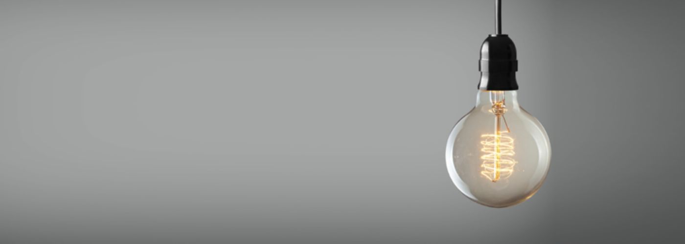 lightbulb hanging down with a grey background