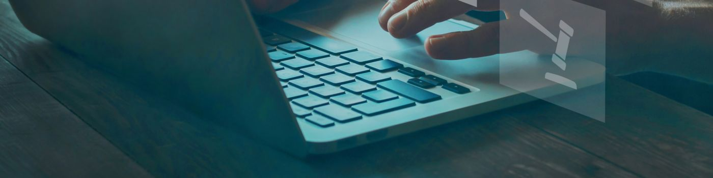 Person typing on computer with icons around