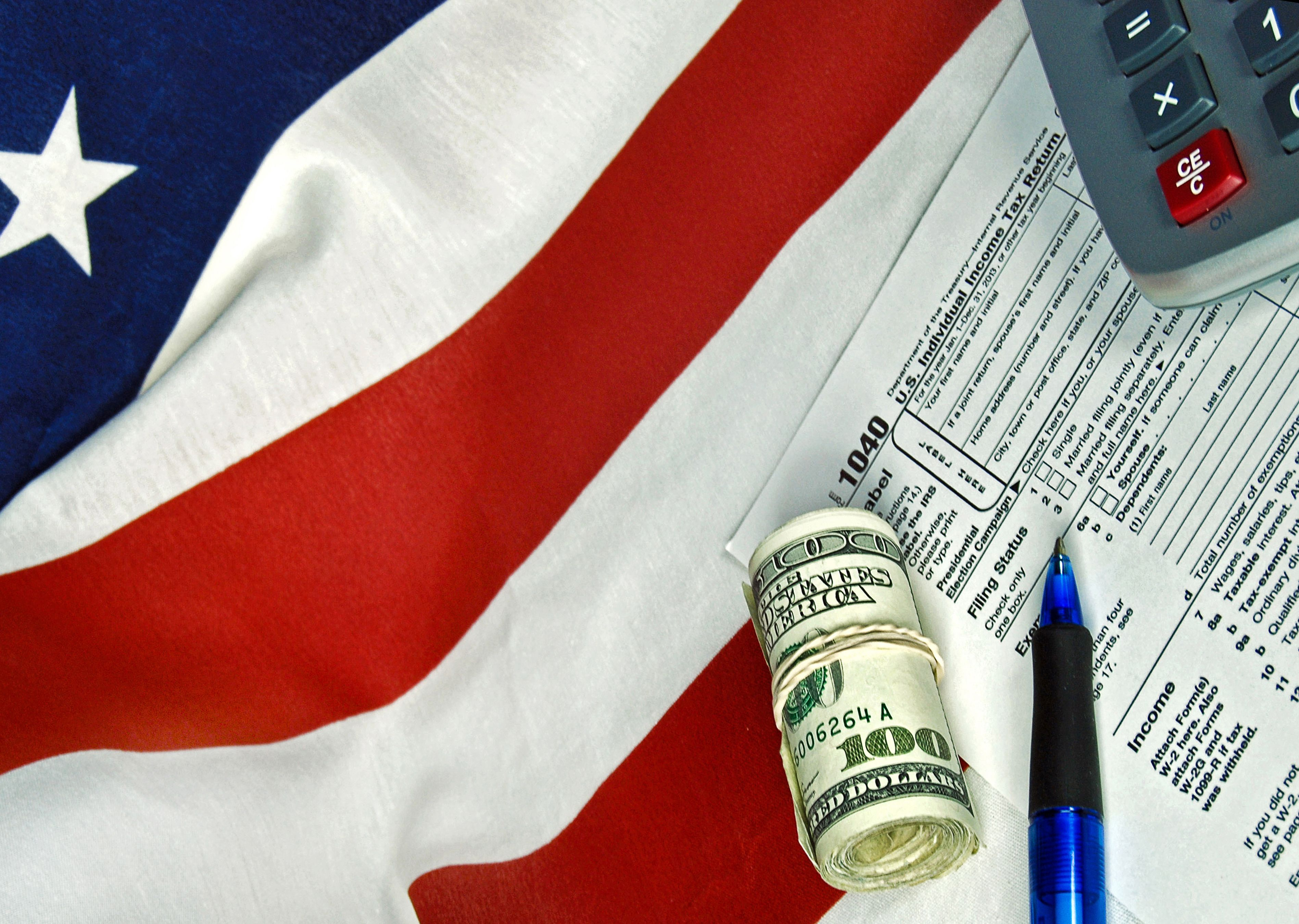 dollar and paper on US flag