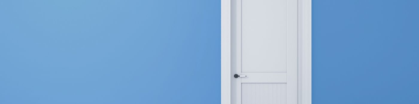 White door on a blue wall