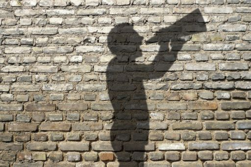 Shadow of a man with a speaking trumpet