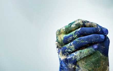 Earth painting on clasped hands