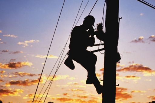 power worker fixing cables