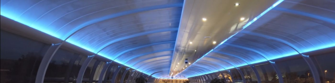 A long tunnel lit with blue light