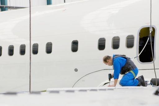 engineer working on jet wing