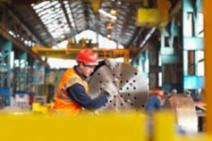 Engineer working on machinery part