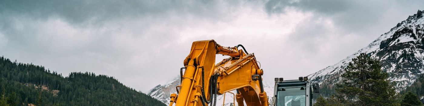 Excavator at work in mountains
