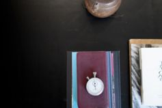 Pocket watch and books placed on a table