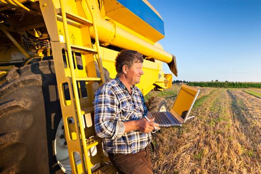 Farmer with a laptop computer