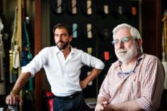 Father and son in their family textile business