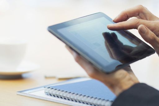 Hand using tablet