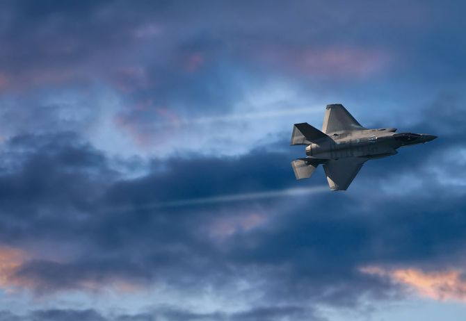 Fighter plane cloudy sky