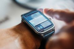 Finger tapping on a smart watch screen