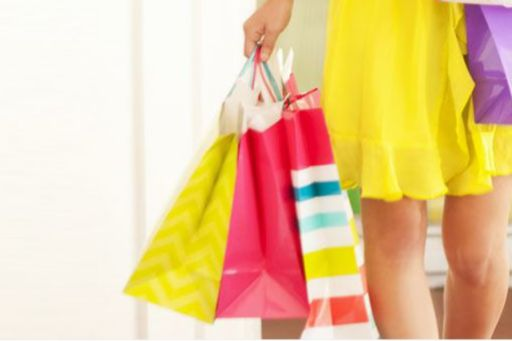 a woman holds shopping bags
