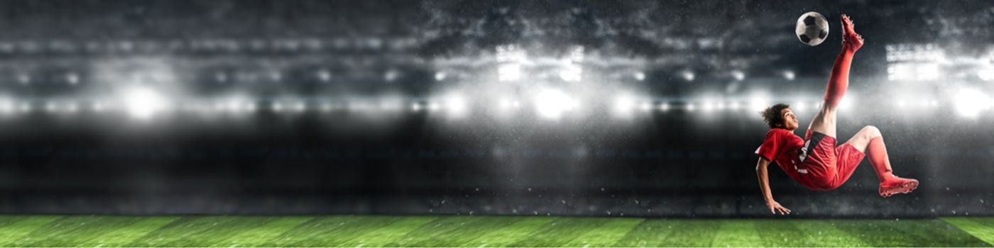 Football player attempting bicycle kick