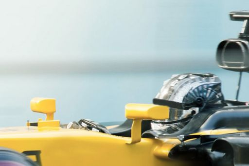 formula one racer in yellow car
