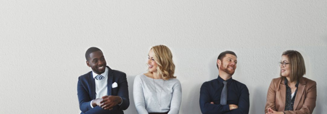 four business people sitting together