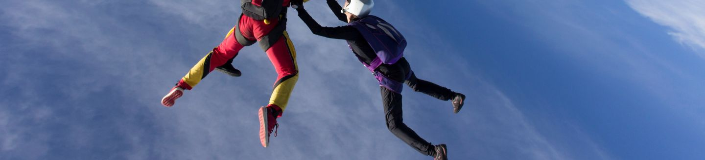 Four skydivers in the sky