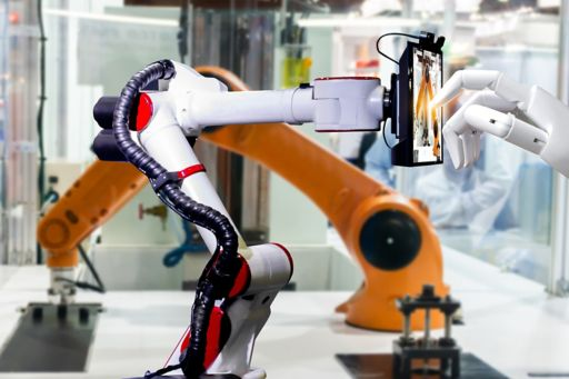 Front view of robotic finger pointing on touch device