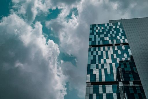 Glass building on cloudy day