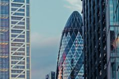 Gherkin building and other London skyscrapers at sunset